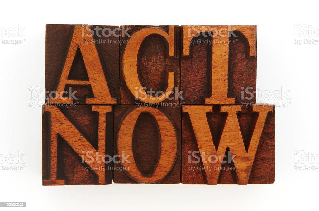 Letterpress - Act Now stock photo