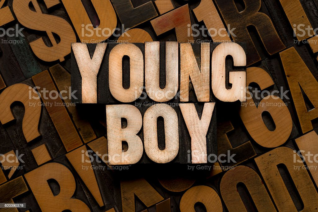 YOUNG BOY - Letterpress letters stock photo