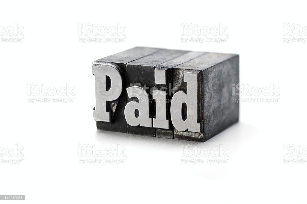 PAID letterpress royalty-free stock photo