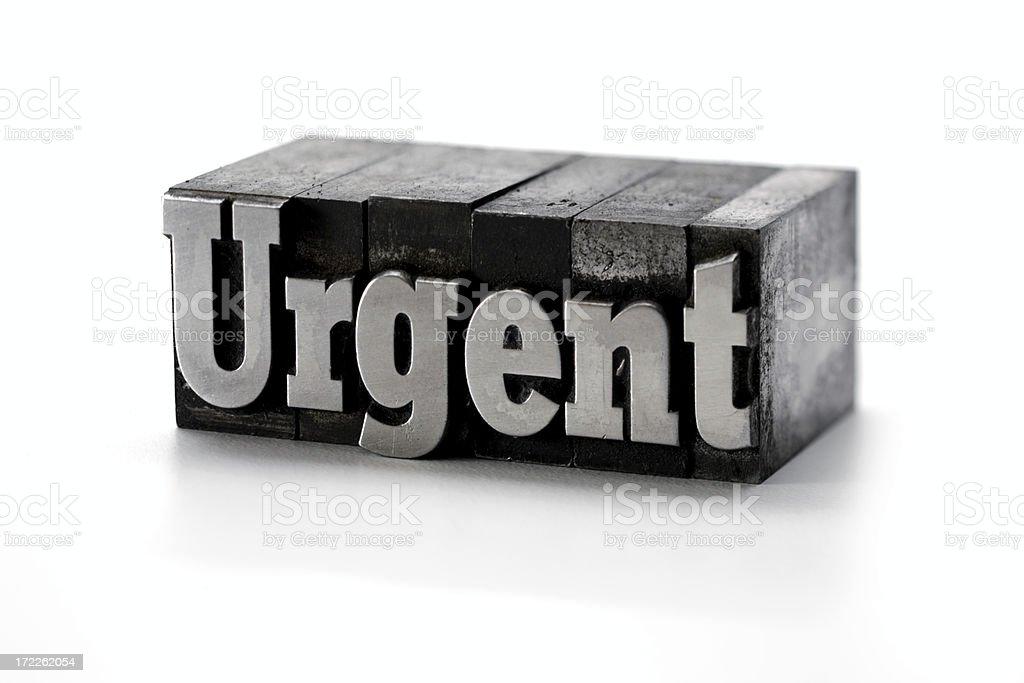 URGENT  letterpress royalty-free stock photo