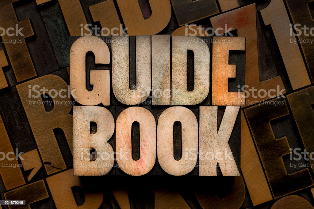GUIDE BOOK - Letterpress type stock photo