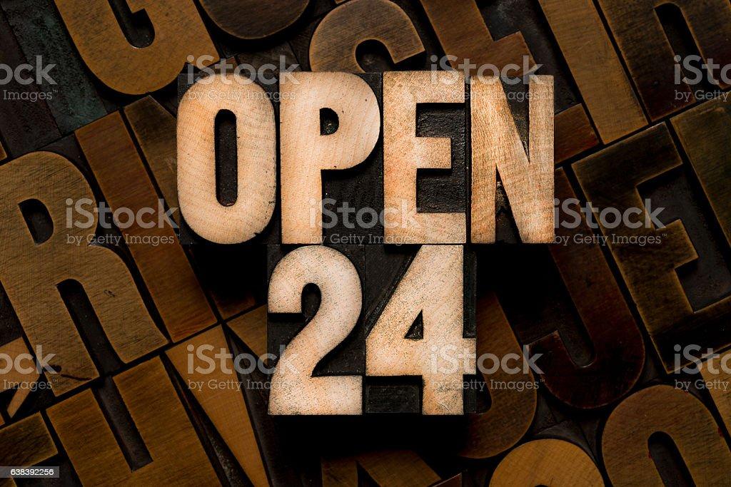 OPEN 24 - letterpress type stock photo