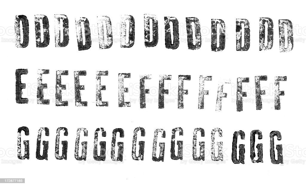 Letterpress uppercase alphabets from D to G stock photo