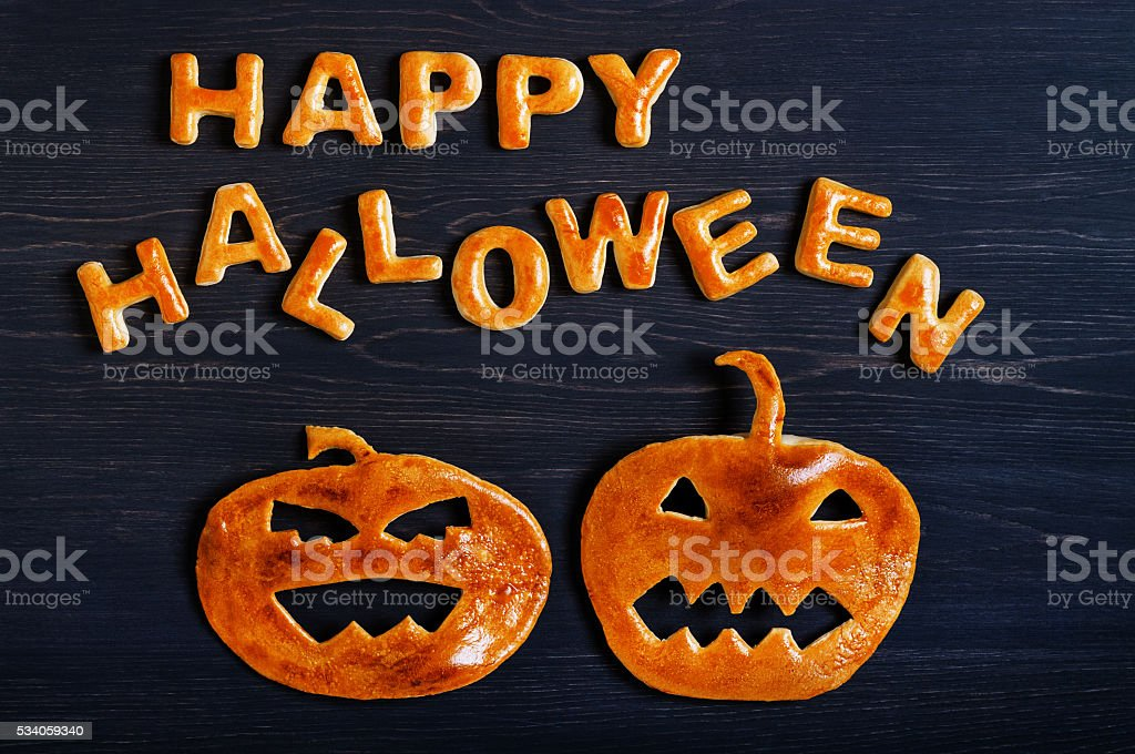 Letters and pumpkin of dough. Halloween background stock photo
