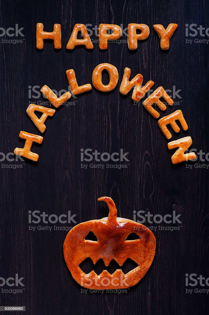 Letters and pumpkin of dough on the wooden table stock photo