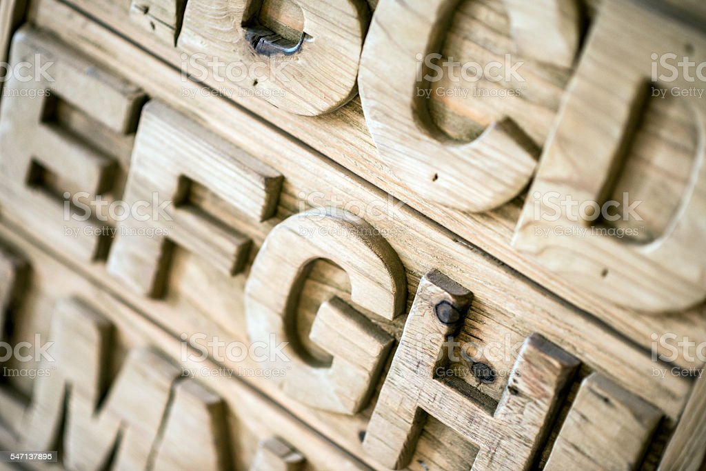 Letters carved in wood stock photo