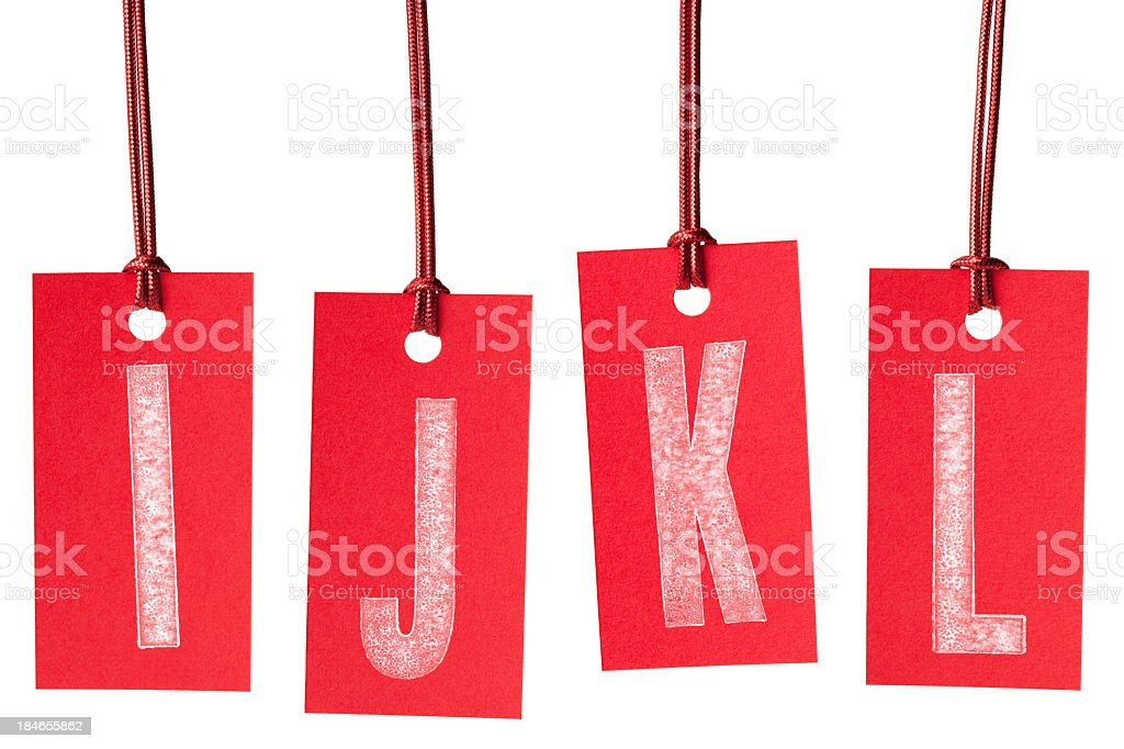 Letters I J K L on red price labels royalty-free stock photo