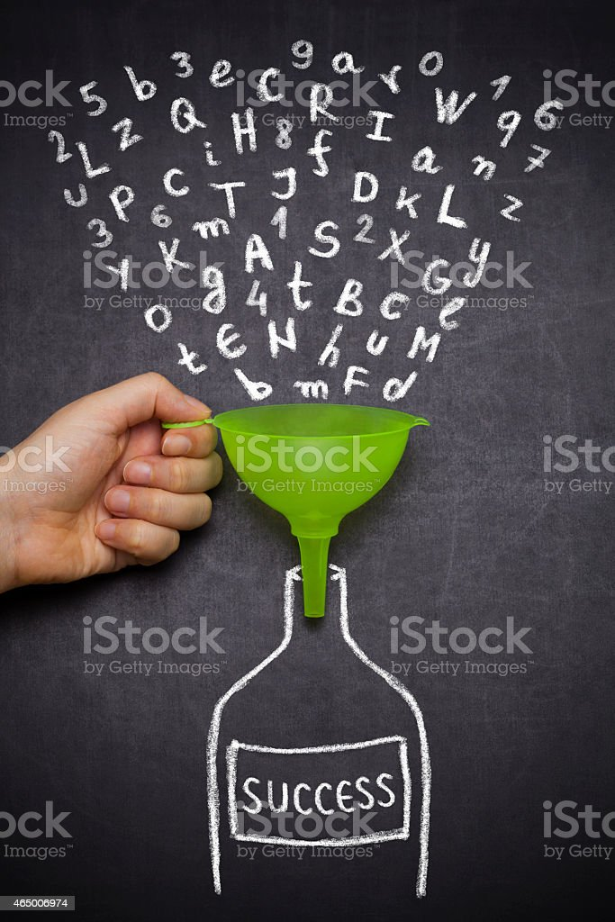 Letters in chalk funnel into bottle shape titled success stock photo