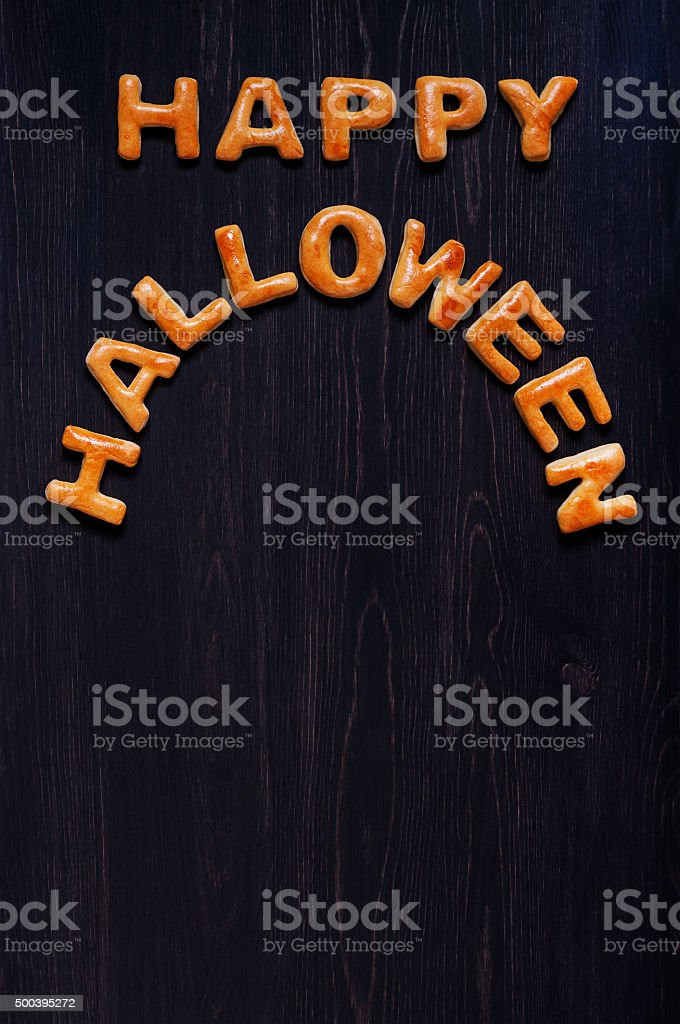 Letters of dough on the wooden table. Halloween background stock photo