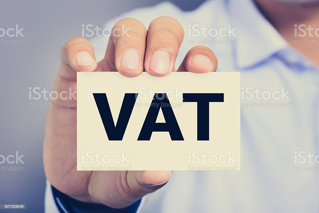 VAT letters (or Value Added Tax) on business card stock photo