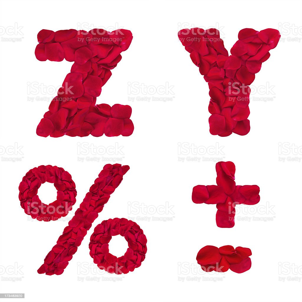 Letters 'Z' 'Y' and symbols '%' '-' '+' made of rose petals royalty-free stock photo