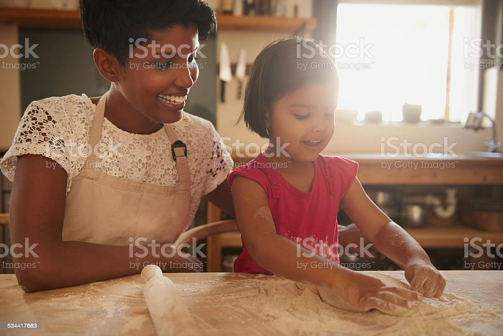 Letting her do the baking stock photo