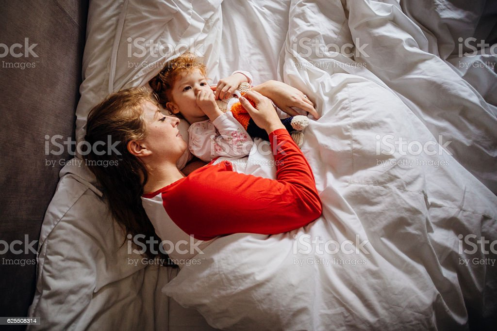 Letting Mum Have a Lie In stock photo