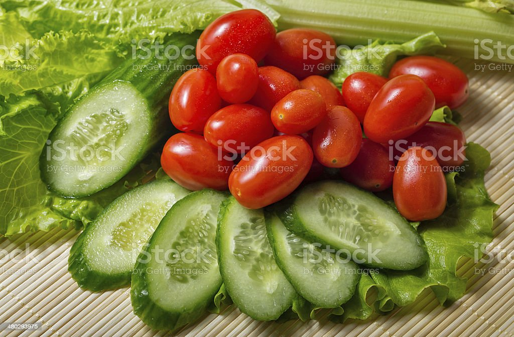 Lettuce, cucumber, tomato and celery stock photo