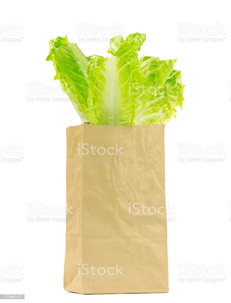 Lettuce in a Paper Bag on a White Background stock photo