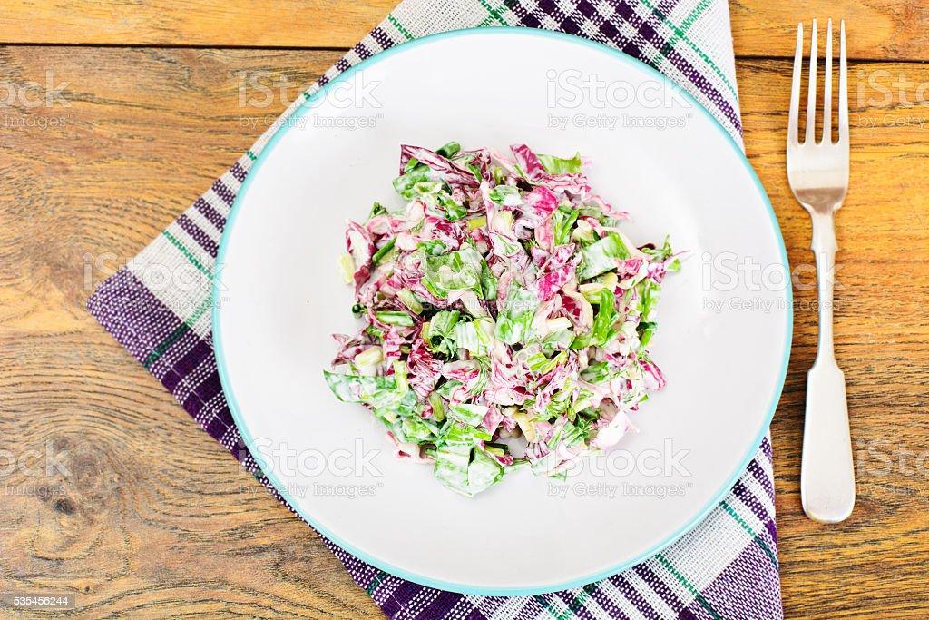 Lettuce, Radicchio and natural low-fat yogurt stock photo
