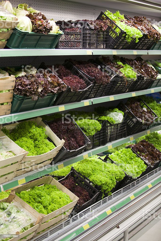 Lettuce section in a grocery store royalty-free stock photo