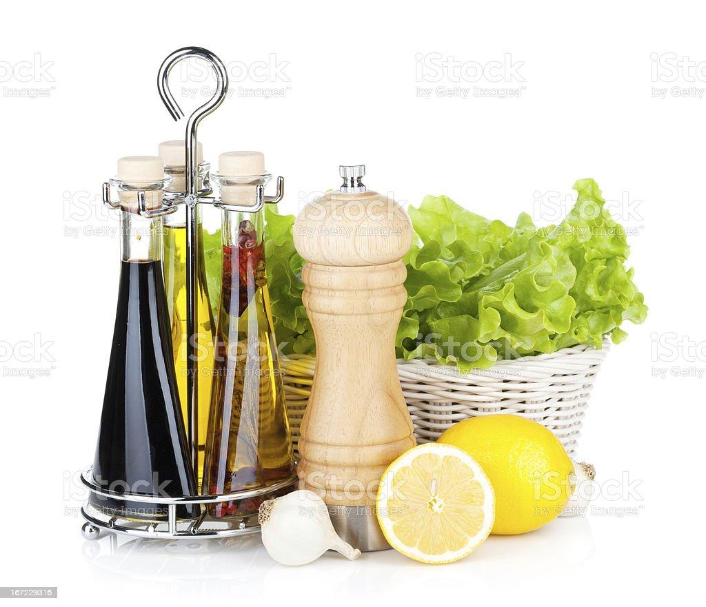 Lettuce with lemons, pepper shaker, olive oil and vinegar royalty-free stock photo