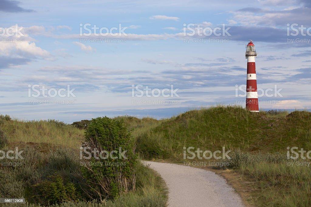 Leuchtturm Ameland mit Dünen stock photo
