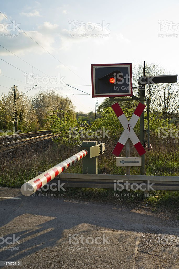 Level grade crossing with red light Germany stock photo