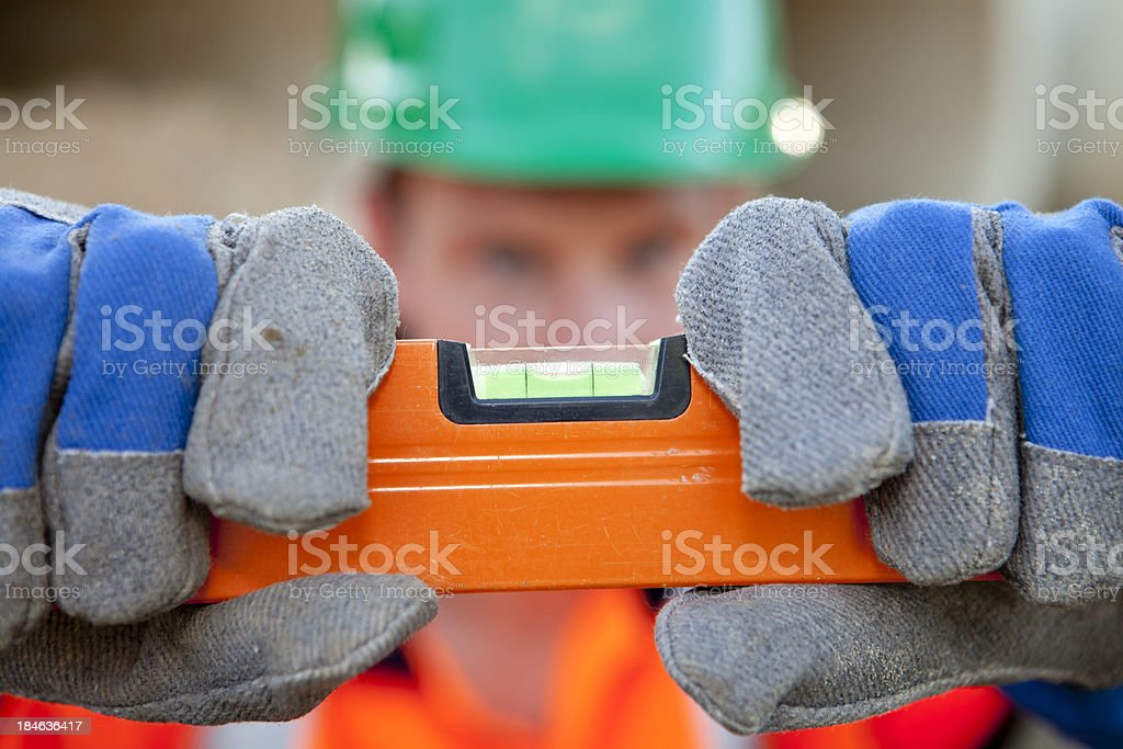 Level in hand of pipefitter. royalty-free stock photo