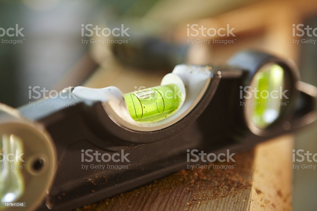 Level Sitting on a Wooden Beam stock photo
