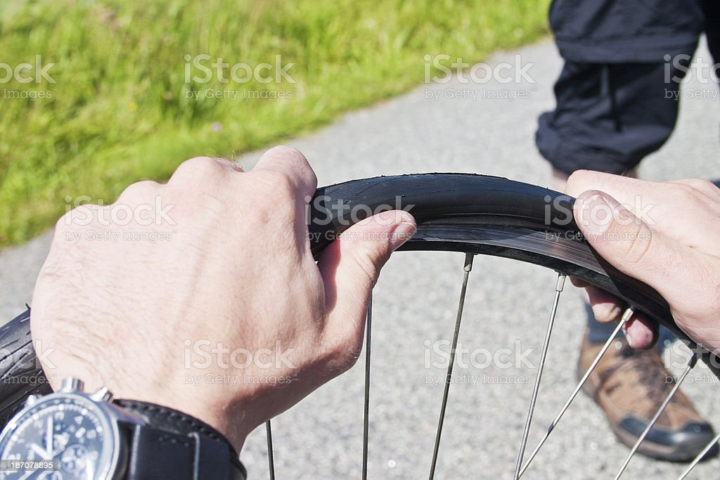 Levering a bicycle tire stock photo