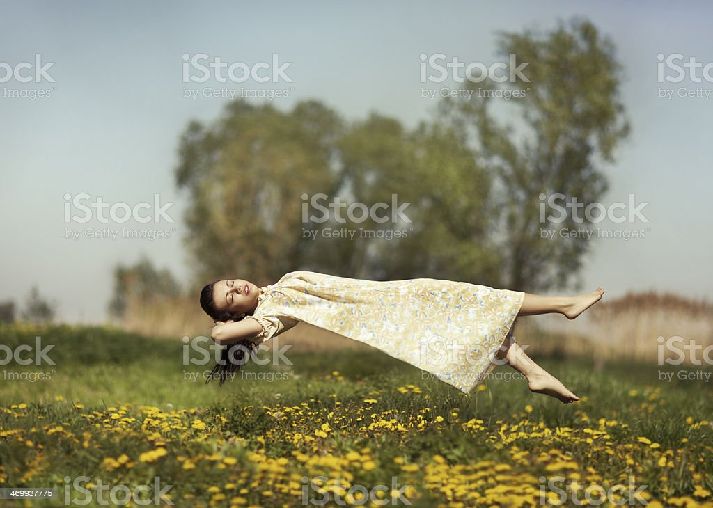 Levitation girls over the field. stock photo