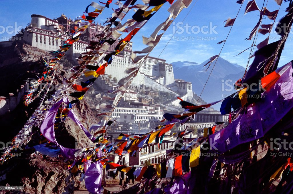 Lhasa, Tibet: The Potala Palace and prayer flags stock photo