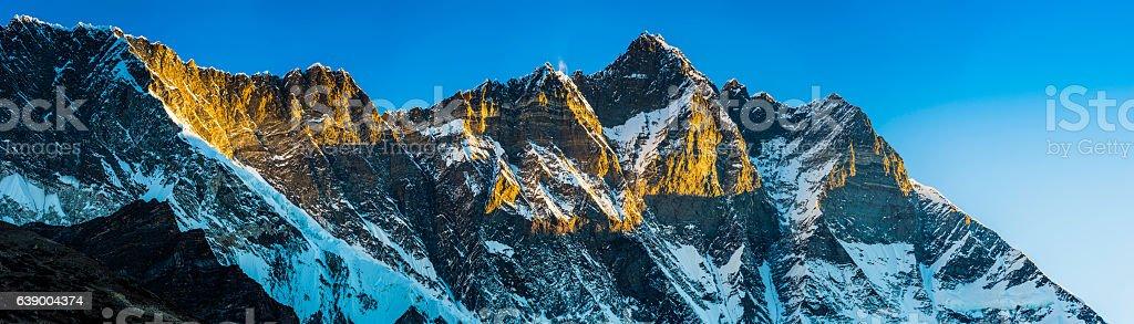 Lhotse 8516m Himalaya mountain peak panorama illuminated by sunrise Nepal stock photo