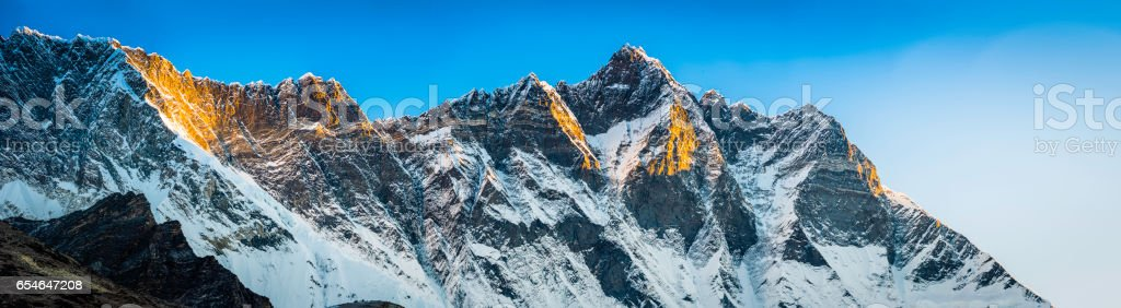 Lhotse 8516m Himalayan mountain peak panorama illuminated at sunrise Nepal stock photo
