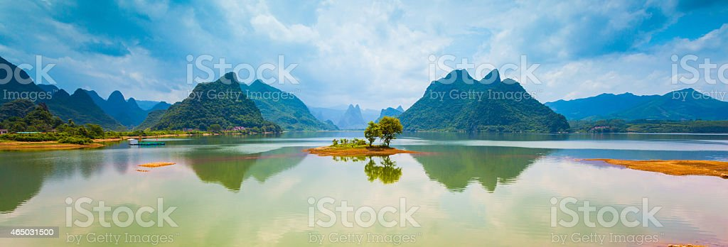 Li Jing river with mountains in background stock photo