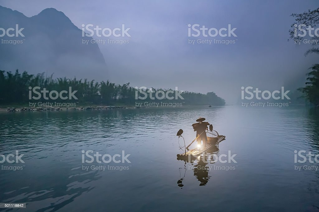Li River Chinese Traditional Fisherman In Early Morning Fog stock photo