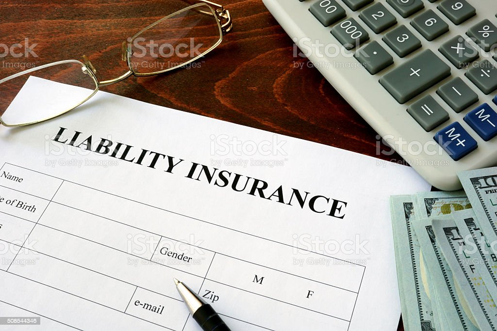 Liability insurance  form and dollars on the table. stock photo