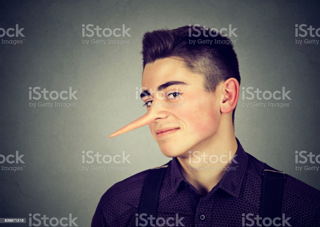 Liar funny looking young man with long nose stock photo