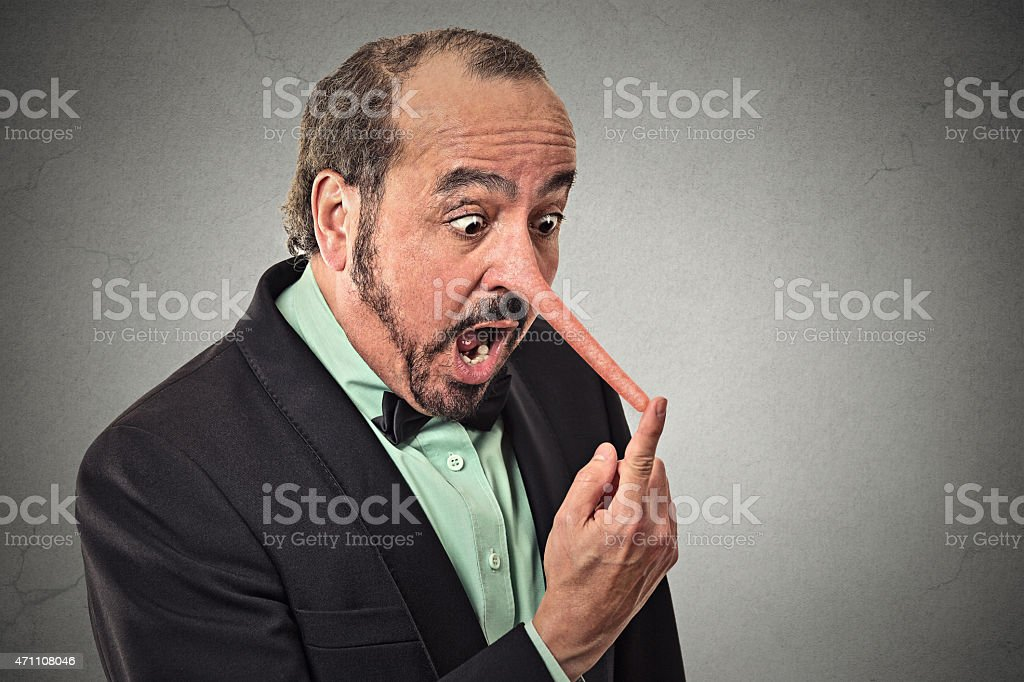 Liar man with long nose stock photo