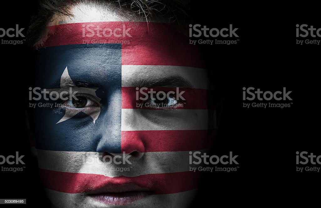 Liberia flag on face stock photo