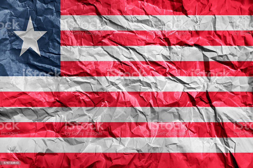 Liberia flag painted on crumpled paper background stock photo