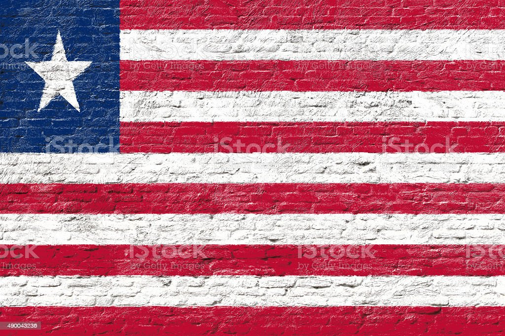 Liberia - National flag on Brick wall stock photo