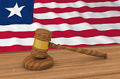 Liberian Law Concept - Flag of Liberia Behind Judge's Gavel