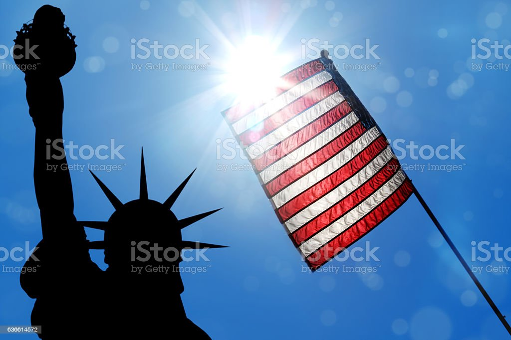 liberty and american flag stock photo