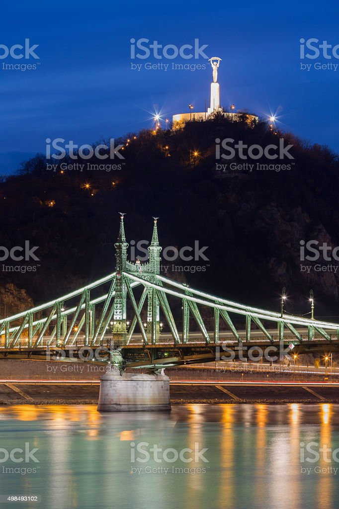 Liberty Bridge and Liberty Statue in Budapest at dusk stock photo