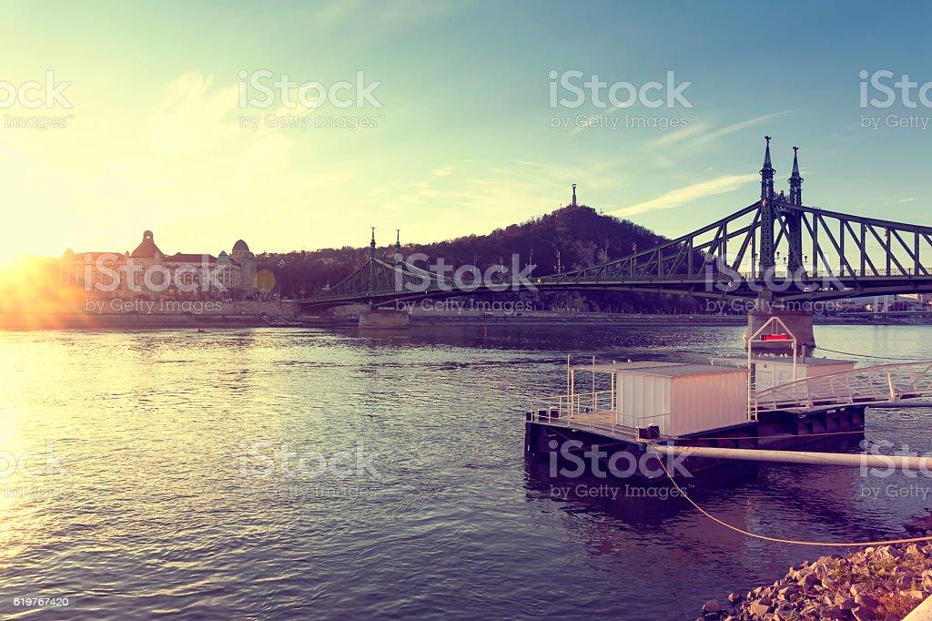 Liberty Bridge and Liberty Statue in Budapest at sunset stock photo