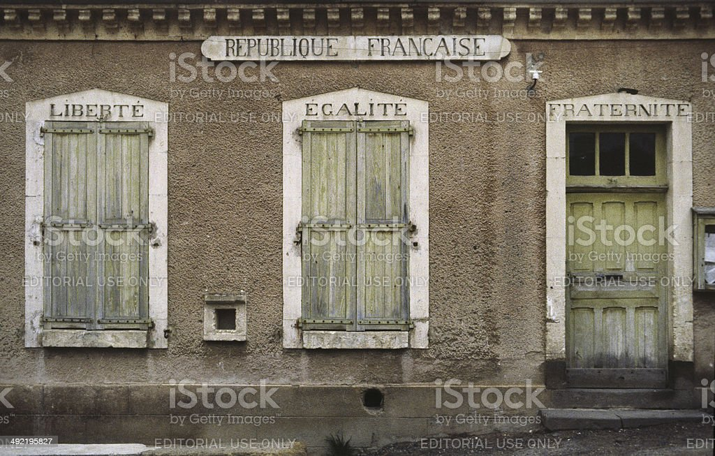 Liberté, Egalité, Fraternité: former town hall in the Cantal, France stock photo