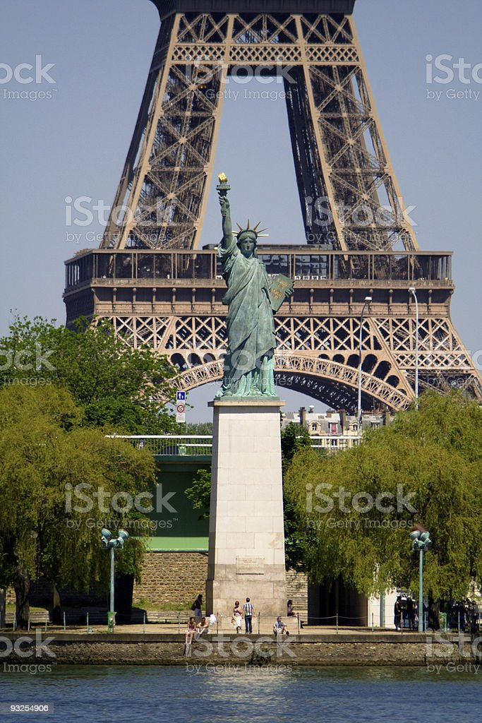 Liberty Statue in front of Eiffel Tower. Paris, France royalty-free stock photo