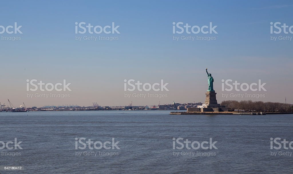 liberty statue in new York during a sunny day stock photo