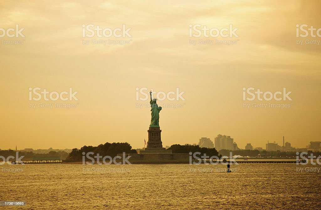 Liberty Statue Silhouette over sunset royalty-free stock photo