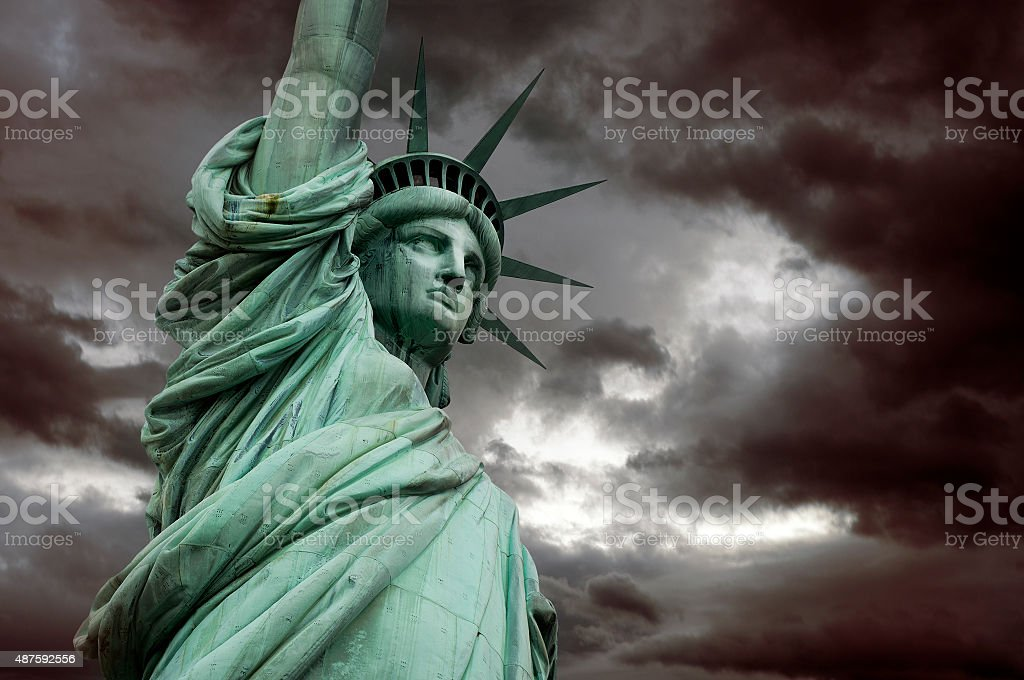 Liberty Staue in stormy clouds, New York stock photo