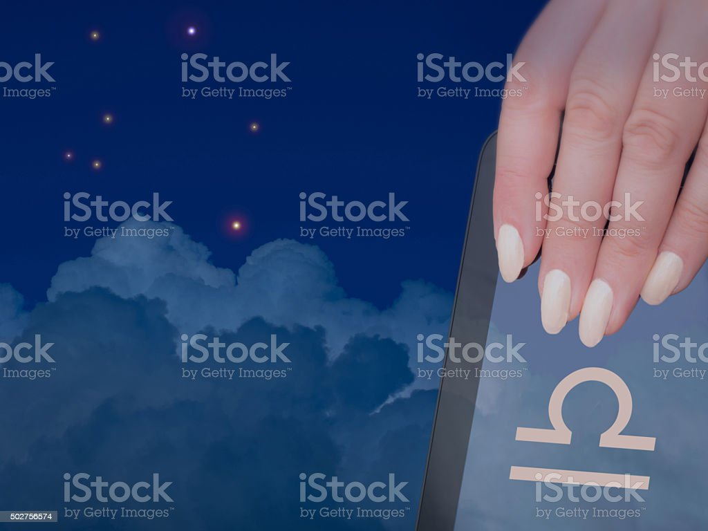 Libra has nude colored nails stock photo