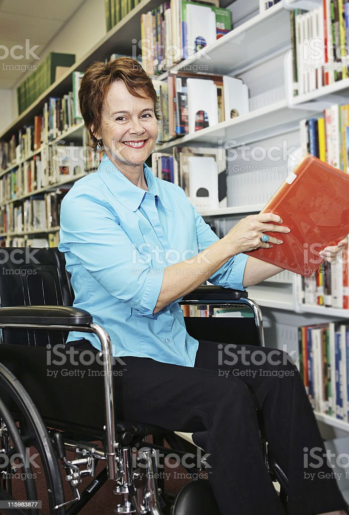 Librarian in Wheelchair royalty-free stock photo
